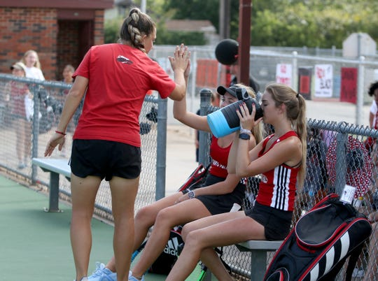 Wichita Falls High head coach Alexandra McClung encourages Jessie Stephon and Julienne Sweeney during their doubles match against Rider Tuesday, Oct. 1, 2019, at Old High.