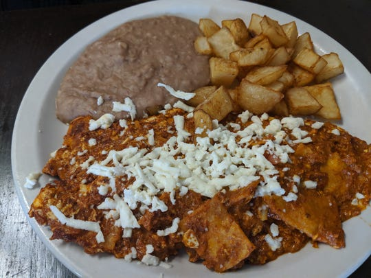 Chilaquiles, scrambled eggs mixed with corn tortillas, jack cheese, salsa and added chorizo, at El Norteno 2.