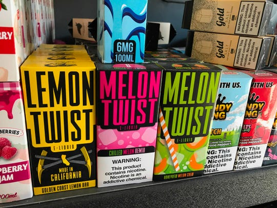 In this file photo taken on September 17, 2019, flavored vaping products containing nicotine are seen in a store in Los Angeles, California.