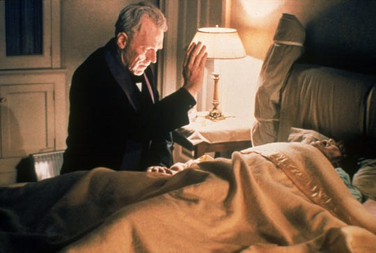 "Father Merrin (Max von Sydow, left) attempts to rid young Regan (Linda Blair) of a demon in the 1973 movie, ""The Exorcist."""