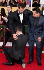 Bradley Cooper, Michael Pena, right, and Vitalii Sediuk (bottom) at the Screen Actors Guild Awards on Jan. 18, 2014 in Los Angeles, Calif.