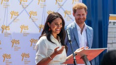 "Meghan, Duchess of Sussex(L), is watched by Britain's Prince Harry, Duke of Sussex(R) as she delivers a speech at the Youth Employment Services Hub in Tembisa township, Johannesburg, on October 2, 2019. - Meghan Markle is suing Britain's Mail On Sunday newspaper over the publication of a private letter, her husband Prince Harry has said, warning they had been forced to take action against ""relentless propaganda"". (Photo by Michele Spatari / AFP) (Photo by MICHELE SPATARI/AFP via Getty Images) ORIG FILE ID: AFP_1KY7WI"