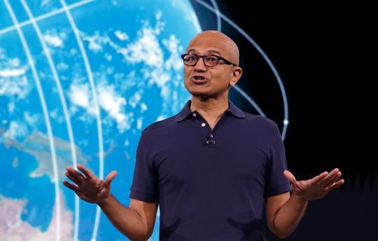 In this May 6, 2019 file photo, Microsoft CEO Satya Nadella delivers the keynote address at Build, the company's annual conference for software developers in Seattle. Microsoft and other tech giants have been competing to strike lucrative partnerships with ExxonMobil, Chevron, Shell, BP and other energy firms.