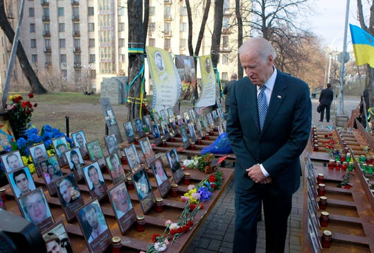 Vice President Joe Biden pays his respects in honor for Maidan activists or the so-called 'Heroes of the Heavenly Hundred' who were killed on the Maidan during anti-government protests in 2014, during a ceremony at the monument dedicated to them, in Kiev, Ukraine, 07 December 2015.
