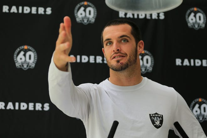 Oakland Raiders' quarterback Derek Carr attends a press conference after a practice session at the Grove Hotel in Chandler's Cross, Watford, England, Wednesday, Oct. 2, 2019. The Oakland Raiders are preparing for an NFL regular season game against the Chicago Bears in London on Sunday.