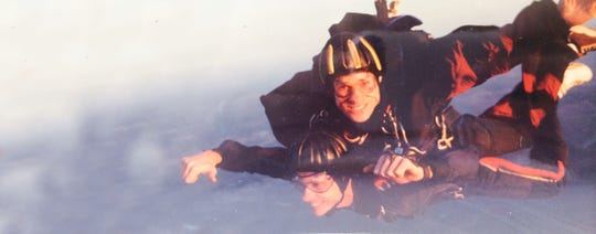 Don Zarda, top, and William Moore skydive for the first time together outside of Dallas in September 2000.
