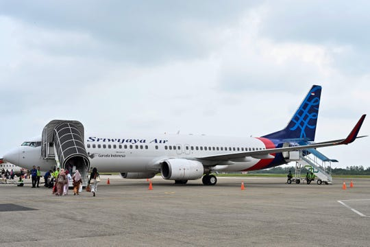 Passengers boarding a Sriwijaya Air Boeing 737-800 aircraft at the airport in Padang, West Sumatra.