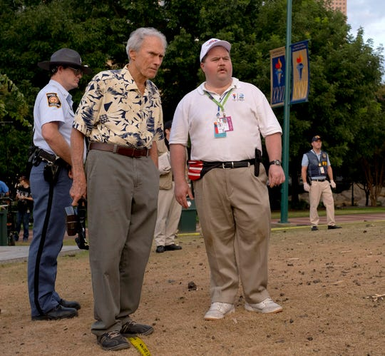 "Director Clint Eastwood with Paul Walter Hauser on the set of ""Richard Jewell."""