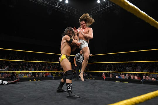 "Matt Riddle, right, puts a knee in the face of Undisputed Era's Adam Cole on ""NXT."""