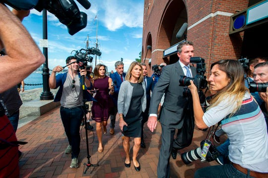 Lori Loughlin and husband Mossimo Giannulli exit the Boston Federal Court house after a pre-trial hearing with Magistrate Judge Kelley at the John Joseph Moakley US Courthouse in Boston on August 27, 2019. Loughlin and Giannulli are charged with conspiracy to commit mail and wire fraud and conspiracy to commit money laundering in the college admissions scandal. The Loughlins later pleaded not guilty to the charges.