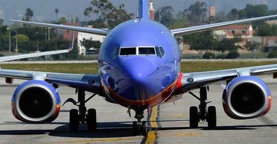A Southwest Airlines Boeing 737-700 passenger jet taxis on the tarmac after arriving at Los Angeles International Airport on April 5, 2011 in Los Angeles, California.