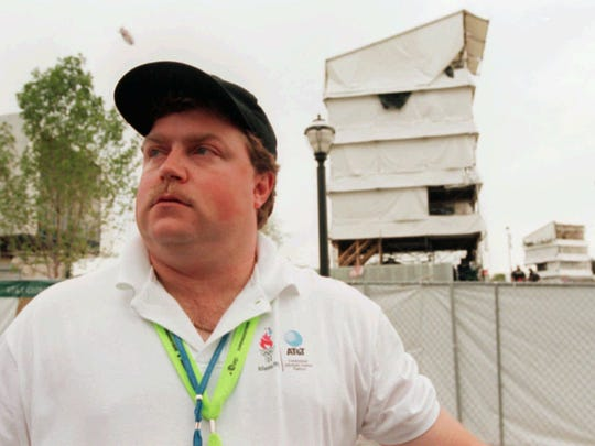 The day after the attack, the real Richard Jewell poses across from the tower where he found a bomb and warned visitors at Centennial Olympic Park.