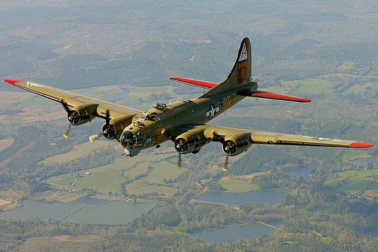 "In this April 2, 2002, file photo, the Nine-O-Nine, a Collings Foundation B-17 Flying Fortress, flies over Thomasville, Ala., during its journey from Decatur, Ala., to Mobile, Ala. A B-17 vintage World War II-era bomber plane crashed Wednesday, Oct. 2, 2019,  just outside New England's second-busiest airport, and a fire-and-rescue operation was underway, official said. Airport officials said the plane was associated with the Collings Foundation, an educational group that brought its ""Wings of Freedom"" vintage aircraft display to Bradley International Airport this week."