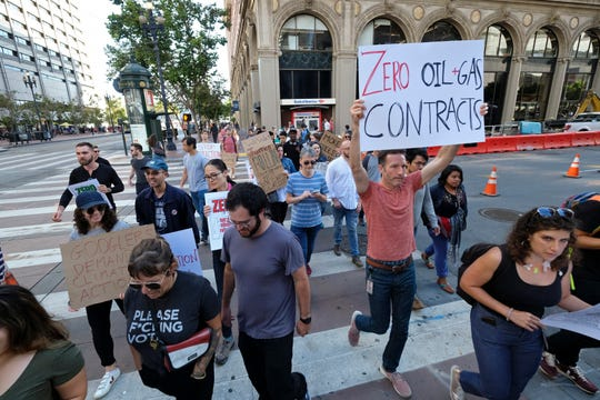 In this Friday, Sept. 20, 2019 file photo, Google employees make their way up Market Street to join others in a climate strike rally at City Hall, in San Francisco. Microsoft and other tech giants have been competing to strike lucrative partnerships with ExxonMobil, Chevron, Shell, BP and other energy firms.