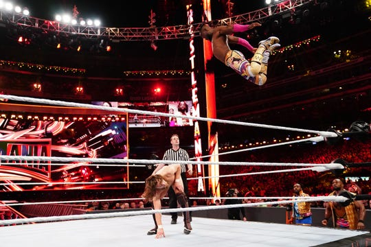 "Kofi Kingston, going airborne on Daniel Bryan, is one of the high flyers of ""WWE Smackdown."""