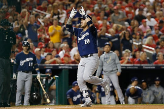 Brewers catcher Yasmani Grandal crosses the plate after hitting a two-run homer in the first inning.