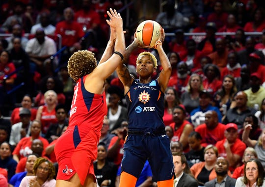 Connecticut Sun guard Courtney Williams (10) shoots over Washington Mystics forward Tianna Hawkins (21) during the second half.