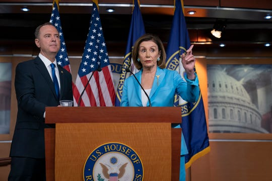 House Speaker Nancy Pelosi, D-Calif., is joined by House Intelligence Committee Chairman Adam Schiff, D-Calif., at a news conference announcing an impeachment inquiry of President Donald Trump.