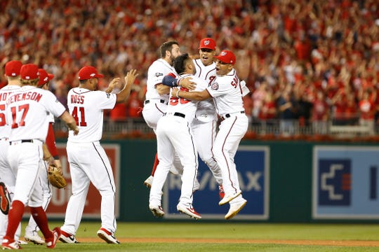 Nationals players celebrate the final out.