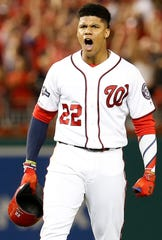 Juan Soto reacts after hitting a three-run go ahead single in the eighth inning.