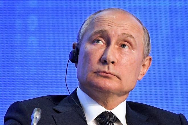 Russian President Vladimir Putin attends the 2019 Russian Energy Week forum in Moscow, Russia, Wednesday, Oct. 2, 2019. Saudi Arabia's Energy Minister Abdulaziz bin Salman is in the center. (Alexei Nikolsky, Sputnik, Kremlin Pool Photo via AP)