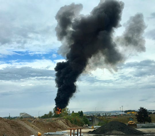 Smoke fills the sky after a World War II-era bomber plane crashed Oct. 2 outside Bradley International Airport north of Hartford, Conn.