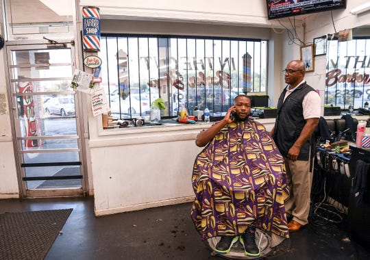 Harold Holland gets ready to give a haircut to Travis Gray at the barber shop In The Cut at the Watson Village shopping center in the Homeland Park community in Anderson, a 29624 zip code.