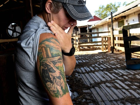 Megan Dobbins of Four M Farms in Townville, talks about her family was invested in the dairy farm business. A portrait of her family farm etched as a tattoo on her arm, and another of her favorite Heifer cow Candy, on the other. The family stopped production after finding they were getting paid 1973 prices for their milk and figured they were earning $6 an hour on the average.