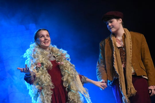 "Grace Roberts portrays the Baker's Wife and Kevin Thomas the Baker in Pineville High School Theatre's presentation of ""Into the Woods."" The musical is about the couple who wants a child. Their story crosses several well-known fairy tale characters such as Cinderella, Rapunzel and Little Red Riding Hood."