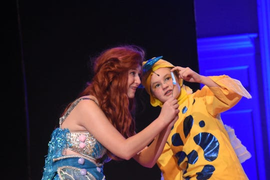 """Emma Sullivan (let) stars as Ariel and Jenevieve Bolen as Flounder in the Bolton Conservatory's production of Disney's """"The Little Mermaid."""""""