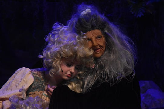 "Zoe Nichols (left) portrays Rapunzel and Emma Babin the Witch in Pineville High School Theatre's presentation of ""Into the Woods."" The musical is about a baker and his wife  who want a child. Their story crosses several well-known fairy tale characters such as Cinderella, Rapunzel and Little Red Riding Hood."
