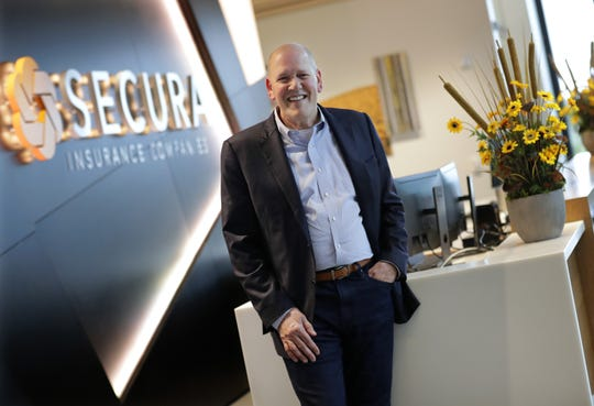 Dave Gross is President and Chief Executive Officer of Secura. He is seen here in the lobby of their new headquarters in Fox Crossing.
