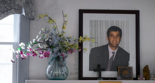 A portrait of Bill Kelly Jr. sits over the mantle in the home of his parents Bill and JoAnne Kelly in Brant Beach on Long Beach Island.