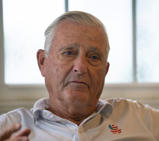 Bill Kelly Sr. wears a shirt featuring the memorial fund's logo.