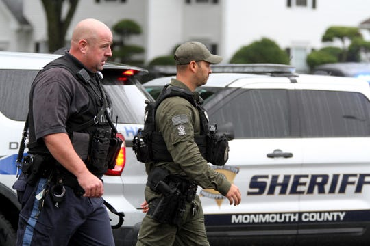 Police officers from across Monmouth County responded to Society Hill Way in Tinton Falls Thursday afternoon, October 3, 2019, where a man was barricaded inside a home.