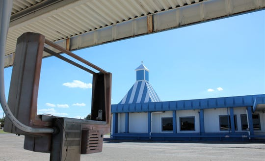 The fall Texas sky can be seen through the frame of the order site at the former Mack Eplen's Driveteria. Food still is the main reason to arrive, however, as the former restaurant now serves as a food pantry.