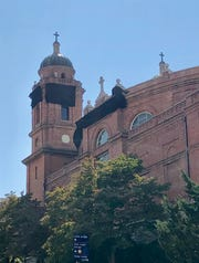 Black cloths have been visible on the Basilica of St. Lawrence in recent weeks. They're part of an engineering study encompassing all the physical changes the structure has gone through since its construction 110 years ago.