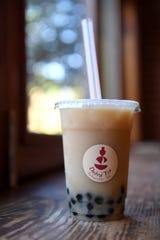 A bubble tea at Dobra Tea in downtown Asheville can be made with Tulsi tea and oat milk and features pearly of tapioca.