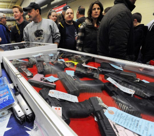 Thousands  of people look to buy firearms at the Asheville Gun & Knife Show at the WNC Agricultural Center in January 2012.