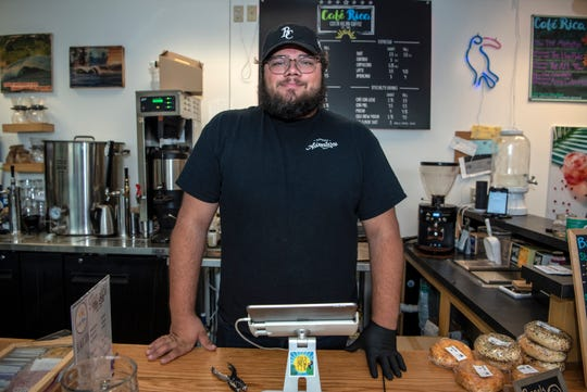 Tristan Bredehoft, who is a co-owner of Café Rica with his brother Jackson, poses for a portrait on Thursday, Oct. 3, 2019 in Battle Creek, Mich. After setting up shop in February 2019, Café Rica is ready to move to a permanent location.