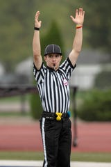 Lakeview junior Aaron Hughes calls a touchdown during an 8th grade football game between Harper Creek and Jackson Lumen Christi on Wednesday, Oct. 2, 2019 at Harper Creek High School in Battle Creek, Mich. Aaron is a baseball player who is spending the fall season working as a football referee alongside his father.