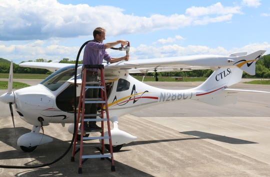 Author and pilot John Lancaster refuels his light sport aircraft after landing at Tri-Cities Airport in May. This was Lancaster's first stop as he retraced the original 1919 transcontinental route.