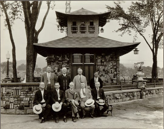 C. Fred Johnson (second from right, second row) and others with the original building in the late 1920s.