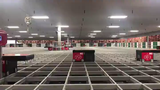 Technology at the new facility at Dick's Conklin Distribution Center includes an AutoStore system with 120 robots that place product into a grid of 97,000 totes.