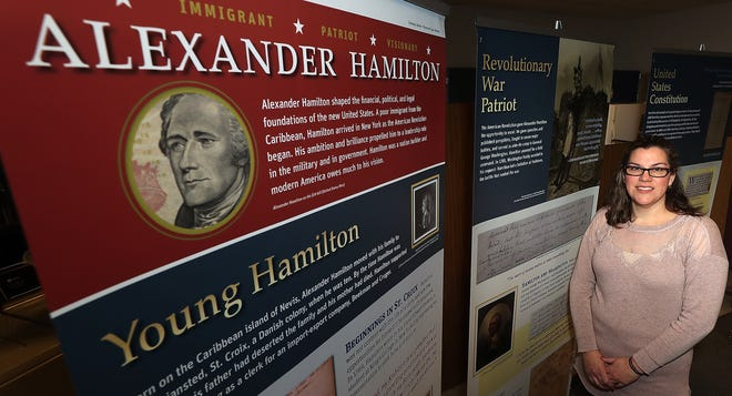 Social studies teacher Anne Pedelaborde with the traveling exhibit, on loan from the Gilder Lehrman Institute of American History in New York City, featuring Alexander Hamilton at Mountain View Middle School in Bremerton on Wednesday.
