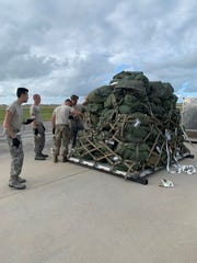 Reserve citizen airmen with the 920th Rescue Wing load an aircraft pallet Saturday at Patrick Air Force Base.