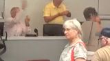 Malabar Town Councilman Dick Korn threw the paper from his chair. Town resident Dawn Danielson, 70, said the crumpled paper struck her in the jaw.
