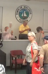 Malabar Town Councilman Dick Korn threw a wadded paper after the Sept. 23 meeting, striking a woman.