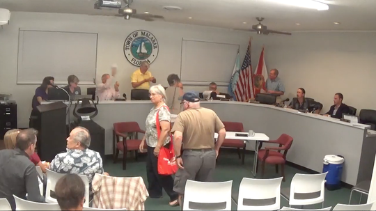 Malabar Town Councilman Dick Korn (seated at the dais) threw a wadded paper immediately after the Sept. 23 meeting.
