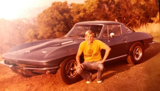 Photo of four time shuttle astronaut Steve Smith taken in 1967 posing with his 1966 Corvette that he still owns. He was one of the speakers at the reveal of the new 2020 mid-engine Chevrolet Corvette at the Kennedy Space Center Visitor Complex Rocket Garden Thursday morning. Photo supplied by Steve Smith.